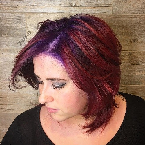 Medium layered burgundy hairstyle for chubby faces