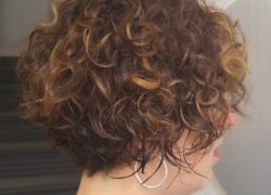 BROWN CURLY HAIR WITH HIGHLIGHTS