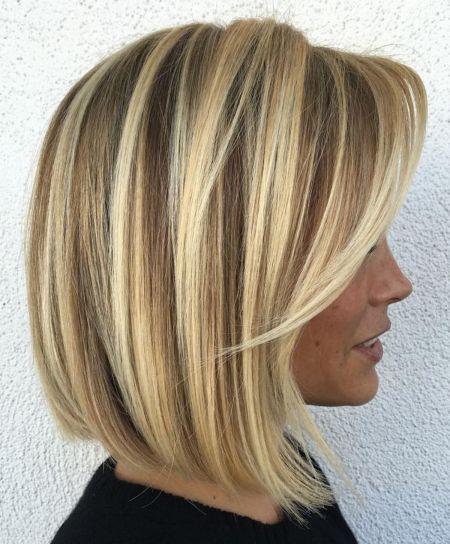 Blonde balayage bob with swoopy bangs