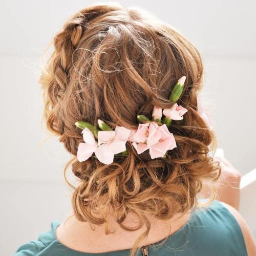 Braided curly updo with flowers