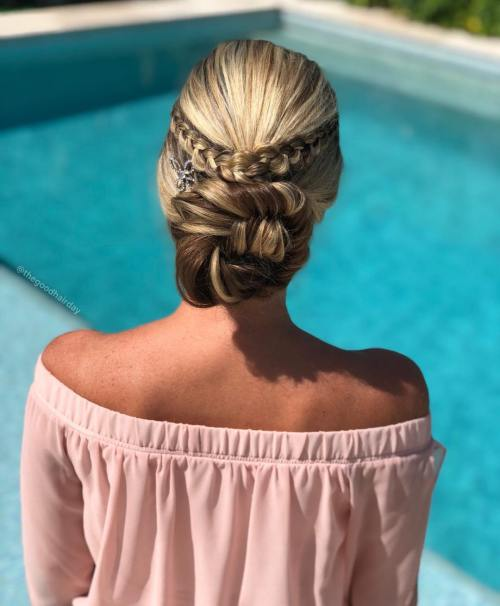 Braided low bun party hairstyle