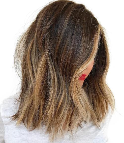 Choppy brunette lob with caramel blonde highlights