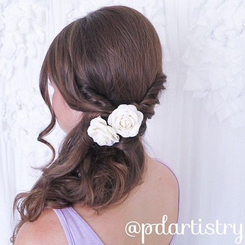 Curly side ponytail with twists and flower