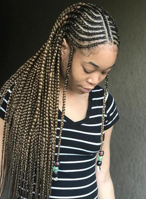 Curved fulani braids with braided centre parting
