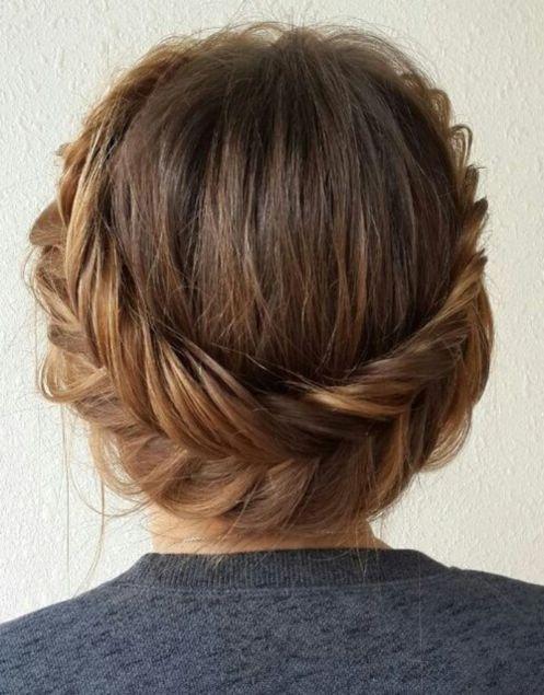 Fishtailed halo updo hairstyle