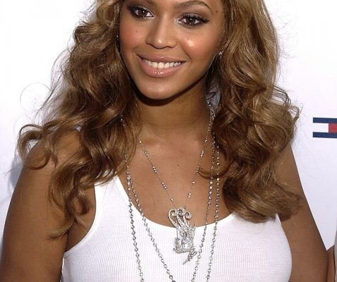 LIGHT BROWN WITH BIG CURLS AND A SIDE PART