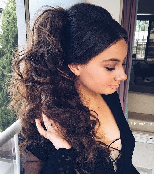 Long curly side ponytail with a bouffant