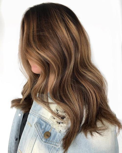 Long dark brown hair with honey balayage