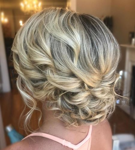 Low curly blonde updo