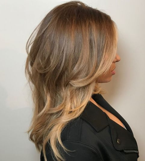 Medium layered caramel bronde hairstyle