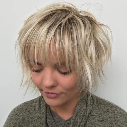 Messy feathered pixie bob with bangs