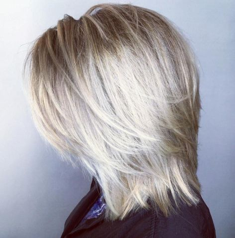 Midlength blonde layered hairstyle