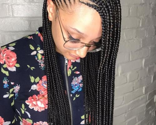 Side parted loose cornrows