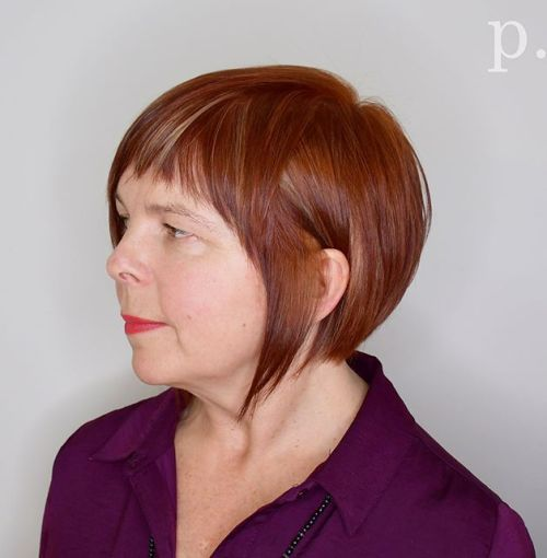Sleek copper red bob with a fringe