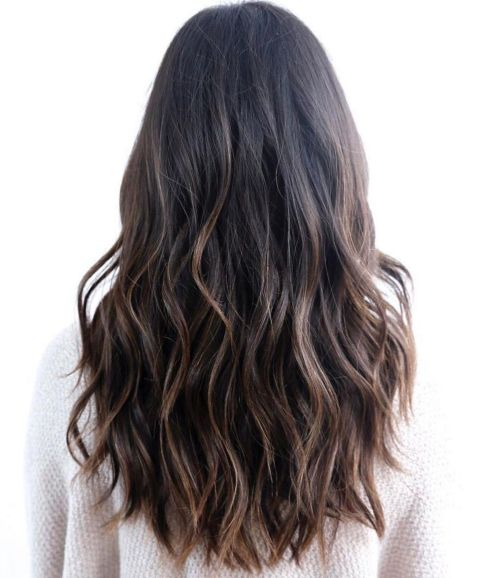 Wavy black hair with brown balayage