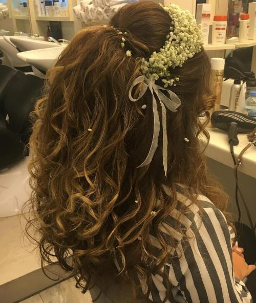 boho bridal half updo with floral headband