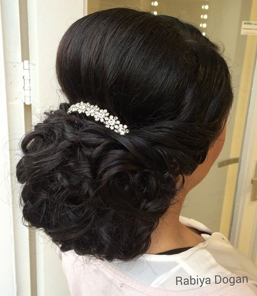 curly wedding updo with a bouffant for thick hair
