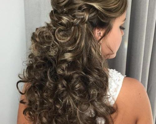 long curly half updo with a braid
