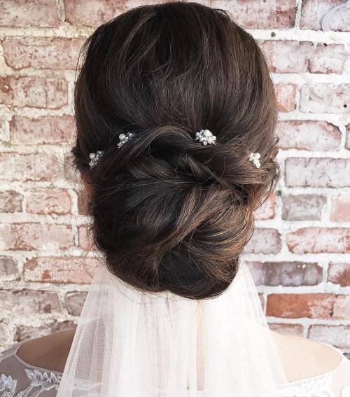 low wedding bun with a veil