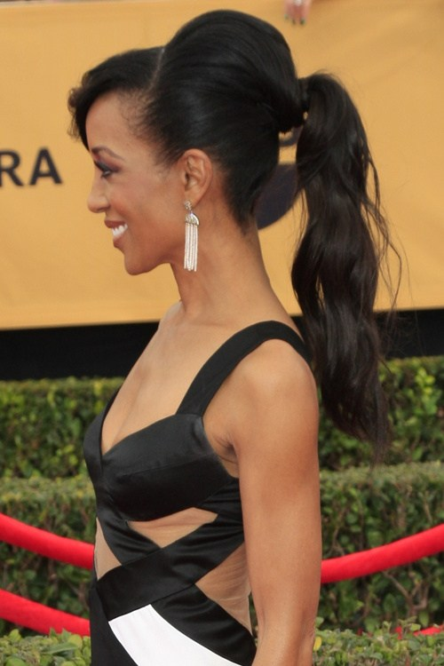Black ponytail hairstyle with a bouffant and bangs