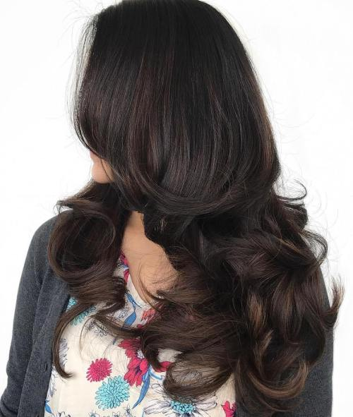 Brunette curled hairstyle for long hair