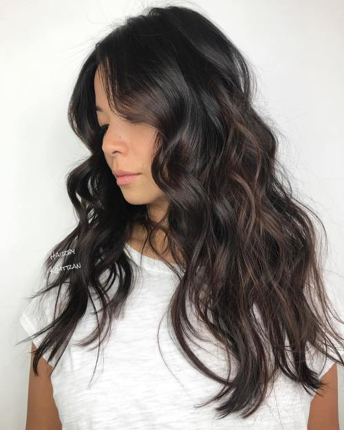 Long tousled brunette hairstyle