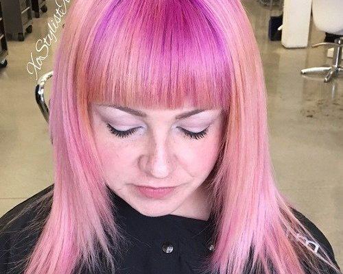 Medium pastel pink hair with straight bangs