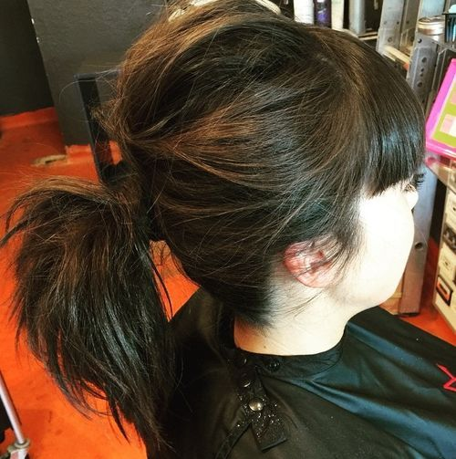 Messy pony for medium hair with bangs