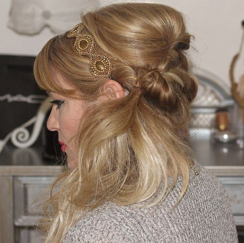 Side hairstyle with bouffant bangs and headband