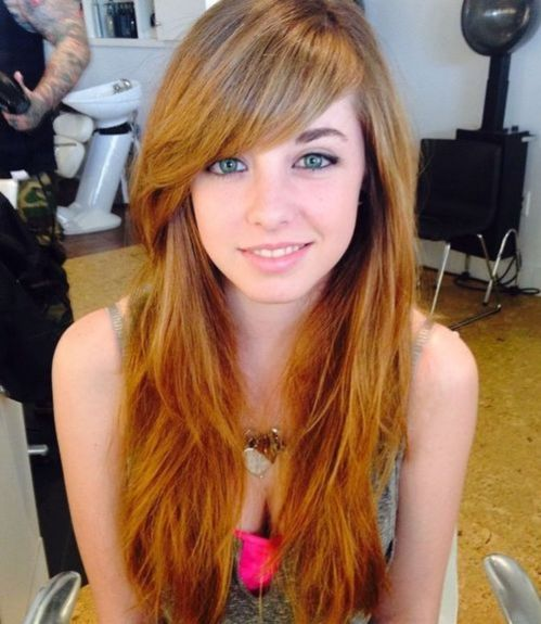 Layered red hairstyle with long side bangs
