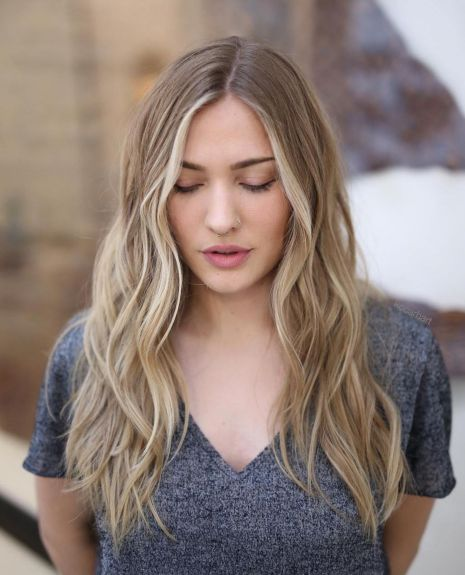 Centreparted beach waves hairstyle