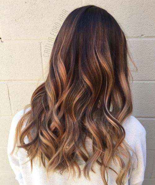 Wavy caramel balayage hair
