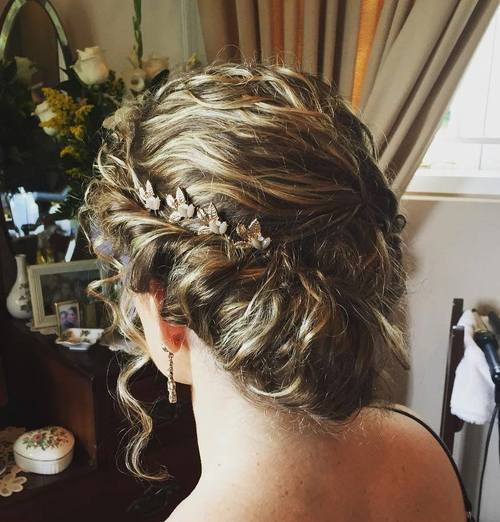 Asymmetrical updo for curly hair
