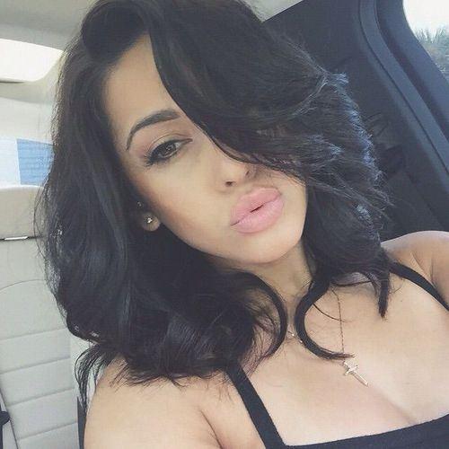 Jet Black Hairstyles with Sultry Curls