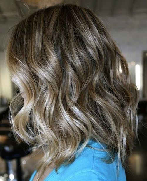 Medium Curly Hairstyle with Ombre Highlights