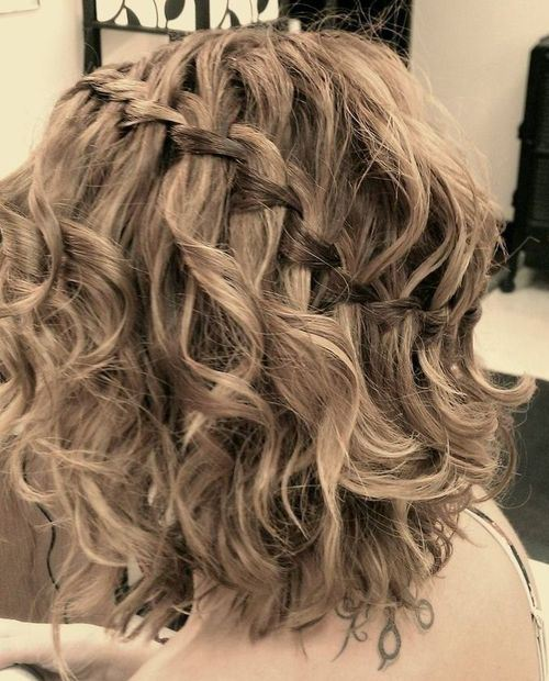 Medium Curly Hairstyle with diagonal Waterfall Braid