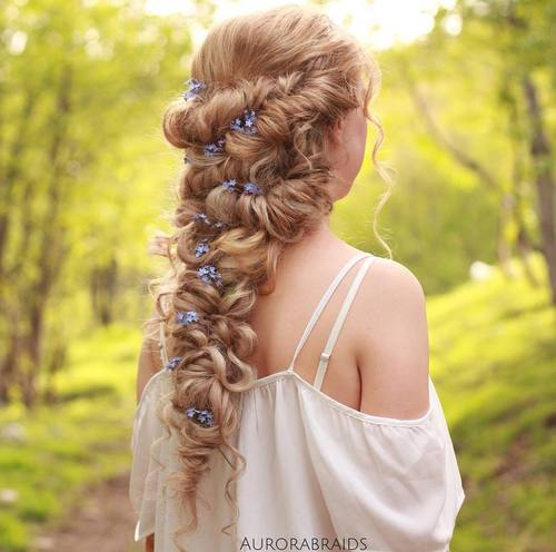 curly downdo with flowers for long hair