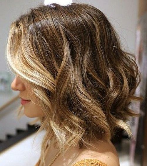 medium Curly Hairstyle with Blonde Face Framing