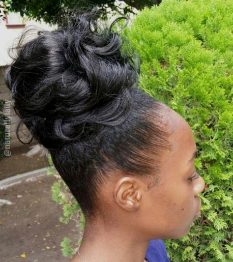 Black curly bun updo