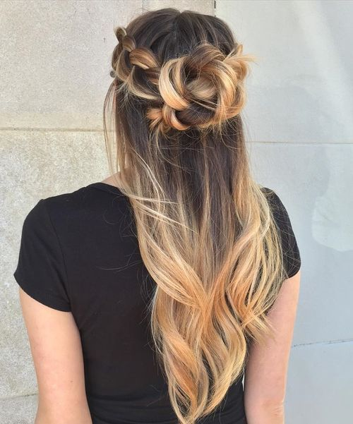Half up messy braided bun for long hair
