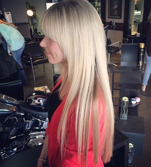 Long layered haircut with arched bangs