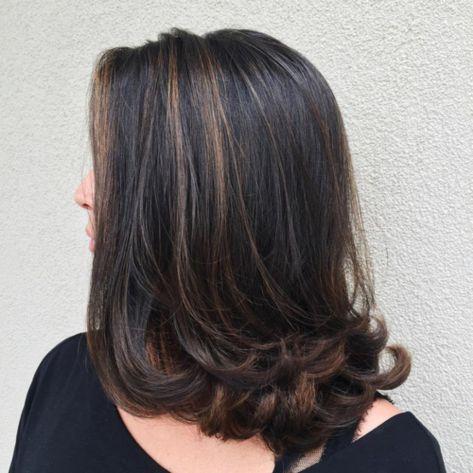Medium brunette hairstyle with flicks
