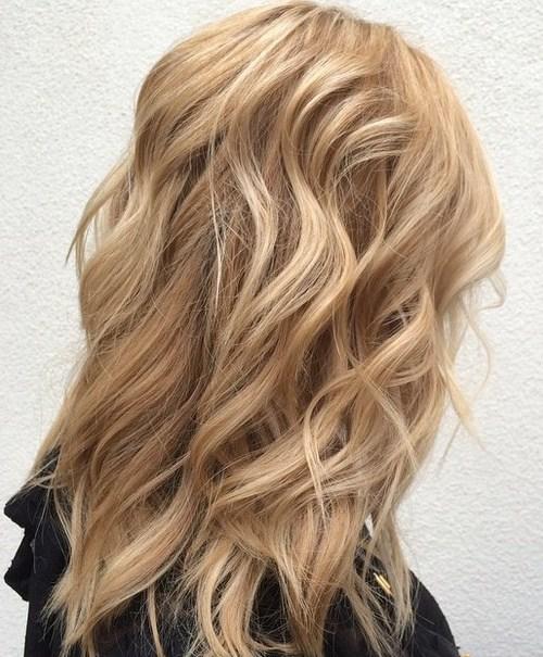 Medium layered sandy blonde hairstyle
