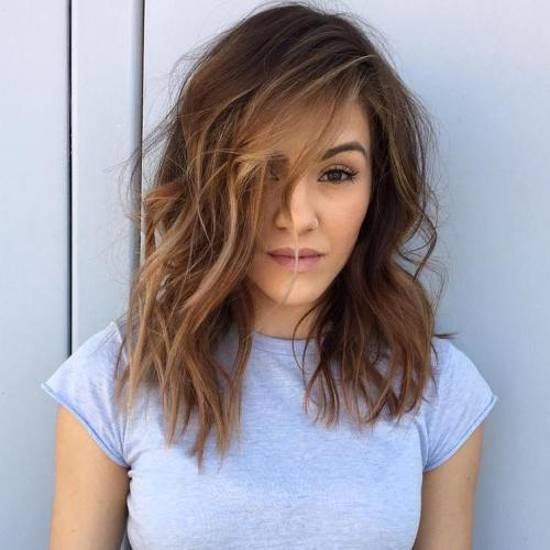 Midlength messy hairstyle with highlights