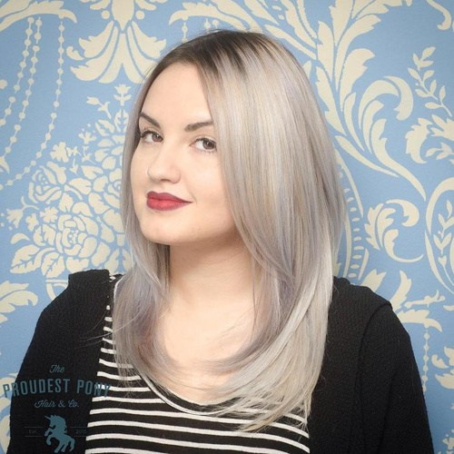 Medium ash blonde layered hairstyle